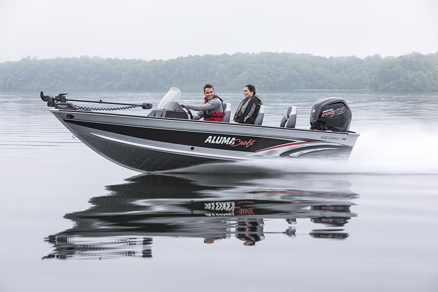 ALumacraft Boat Company, Upper Whitefish Lake, Running shot, happy couple, fishing, fishing boat on plane, rainy day.