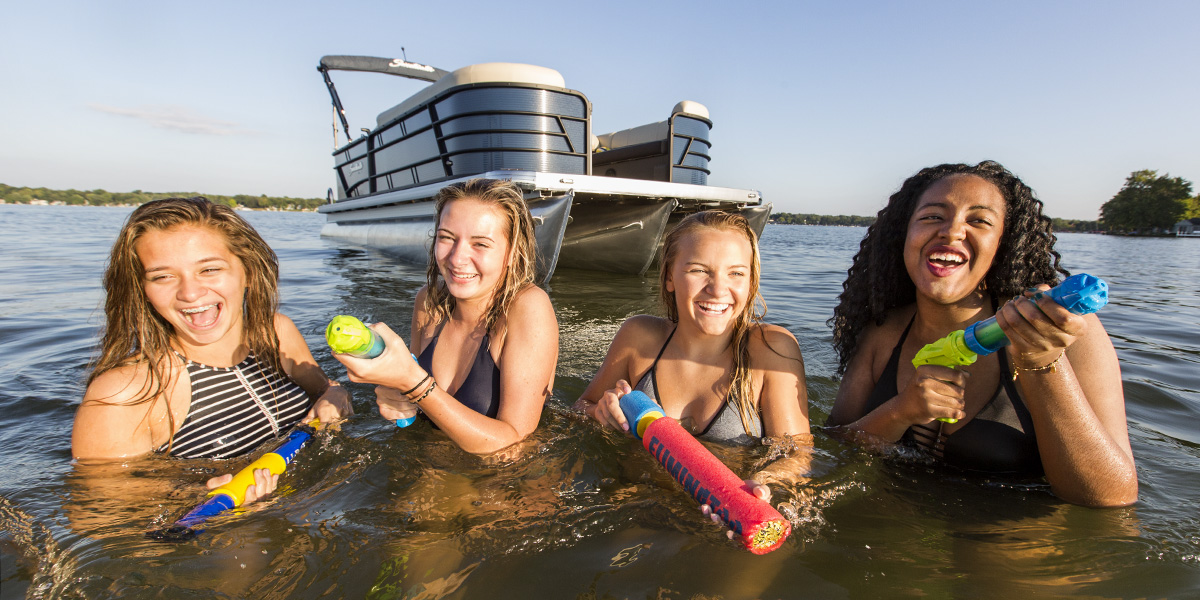 Godfrey Marine, Sweetwater Pontoon, Lake Wawasee, Indiana, Family boating, lake, Yamaha Outboard Motor, Sunset, Girls, Young Girls, Water Fight, Squirt guns, bikini, sandbar