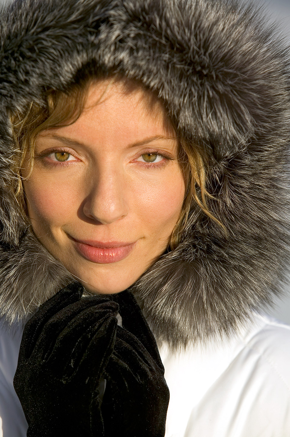 Beautiful young face, fur lined hood, parka, winter, cold, snow, eyes,