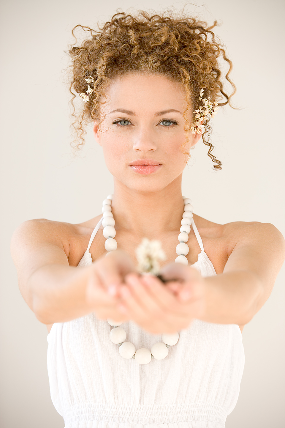 Young woman, white dress, pearl necklace, curly hair, gift